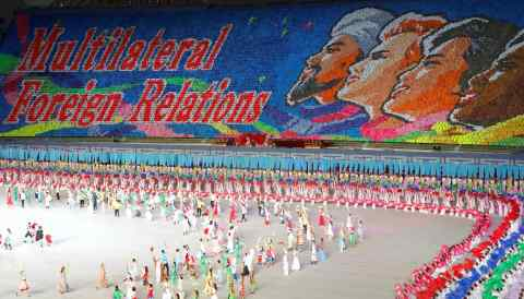 """North Korea's """"mass games"""" on Sunday featured English-language messages with a conciliatory tone."""