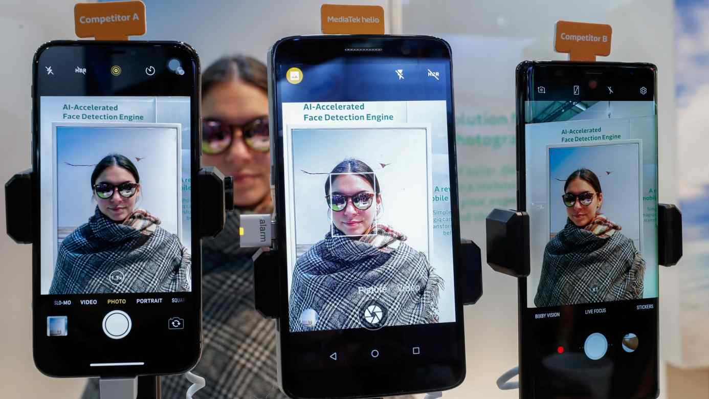 Mobile phones with MediaTek Helio AI-Accelerated Face Detection Engine are presented during the Mobile World Congress in Barcelona