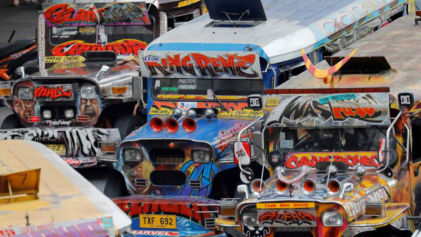 Jeepneysare known for their flamboyant colorsand black exhaust, a major source of pollution in Philippinecities.