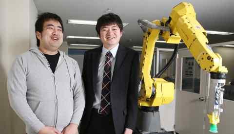 oru Nishikawa and Daisuke Okanohara in the lab