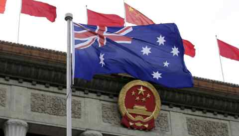 Australia's flag flutters outside the Great Hall of the People in China's capital Beijing.