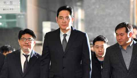 Samsung Electronics heir apparent Lee Jae-yong, center, has kept a low profile since being released from prison in February.