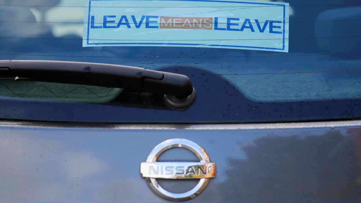 A pro-Brexit sticker adorns a Nissan car in the U.K. Nissan and Japanese peers face the loss of tariff-free exports to the continent in Britain's split from the EU.