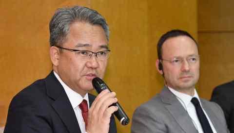 Pioneer President Koichi Moriya, left, and Baring Private Equity Asia CEO Jean Eric Salata speak to reporters in Tokyo. (Photo byKarina Noka)