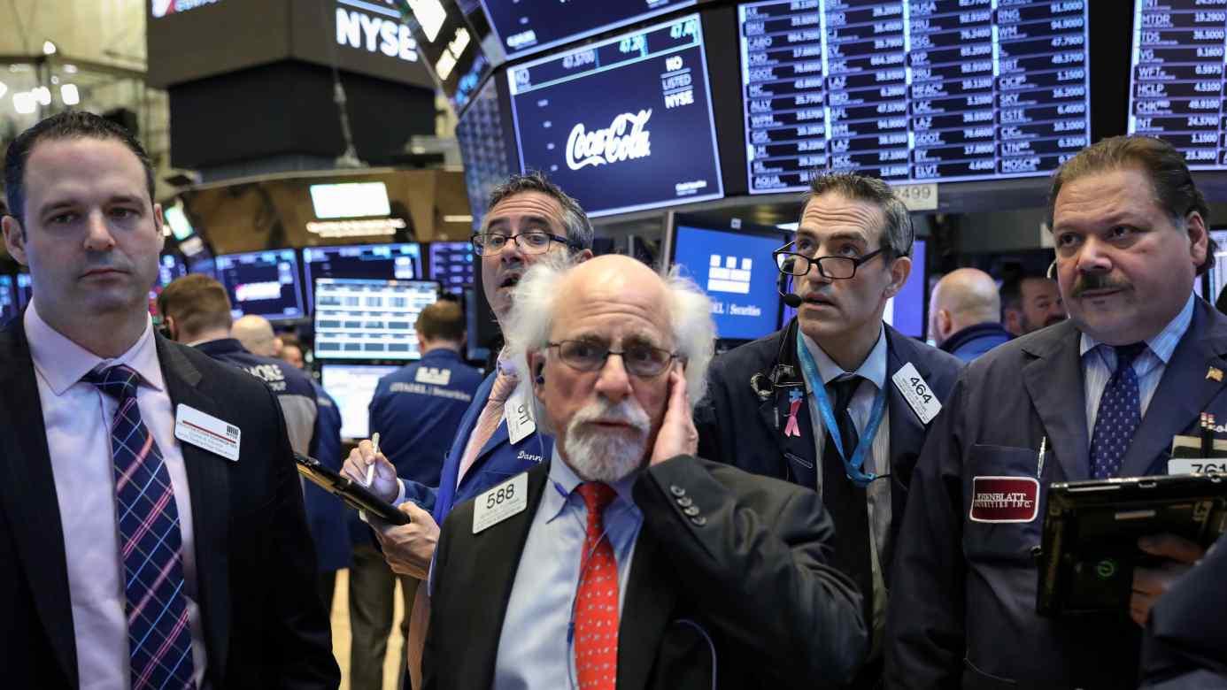 Traders work on the floor of the New York Stock Exchange onJan.28.