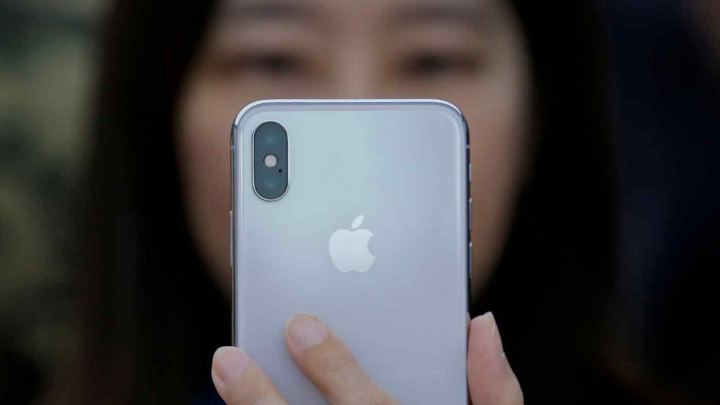 A attendee uses a new iPhone X during a presentation for the media in Beijing.