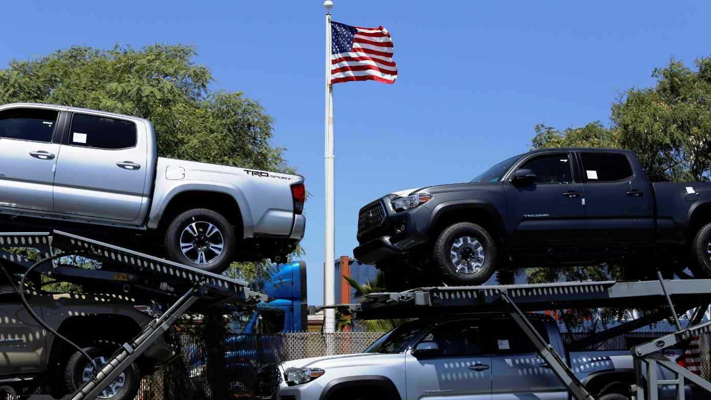 Toyota pickup trucks on a car carrier in the U.S. The revamped North American Free Trade agreement will require 75% of car parts to be made locally.