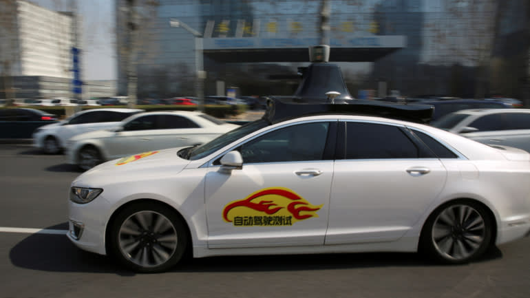 AnApollo autonomous car from Baidu during a public road test for self-driving vehicles in Beijing onMarch 22.