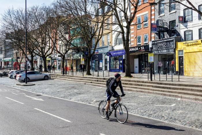 Rental prices dropped in inner London (pictured: Islington High Street) as people left the city but market reforms had already hit landlords hard