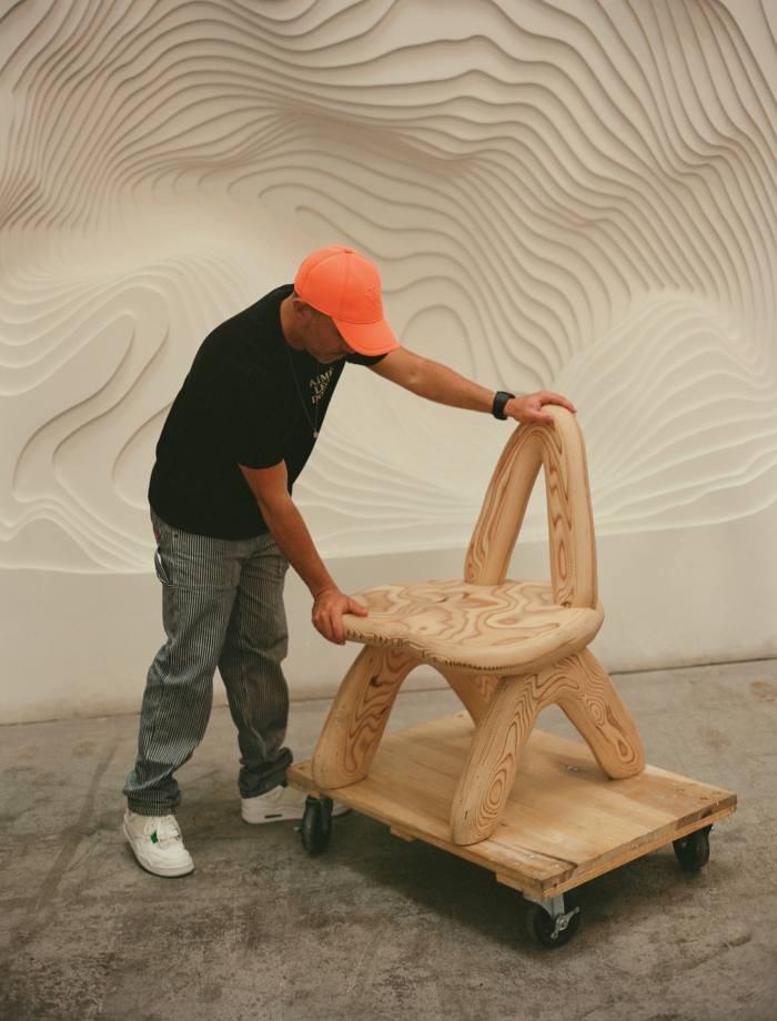 Arsham with the prototype of the Dino Dining Chair