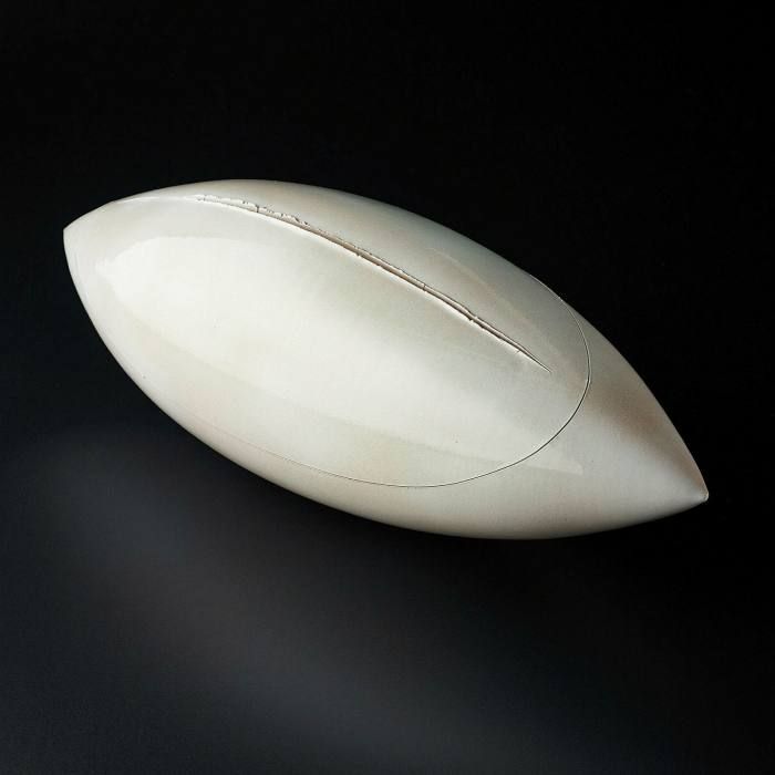 A white object in the shape of a rugby ball