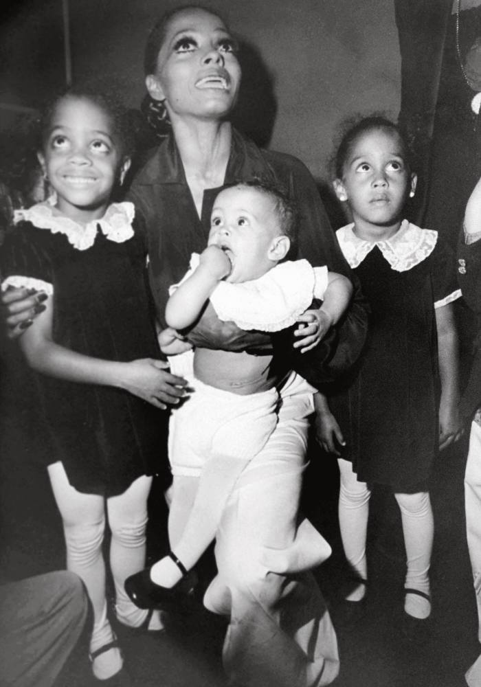As a baby with her mother and sisters Rhonda (left)and Chudney (right)in 1976