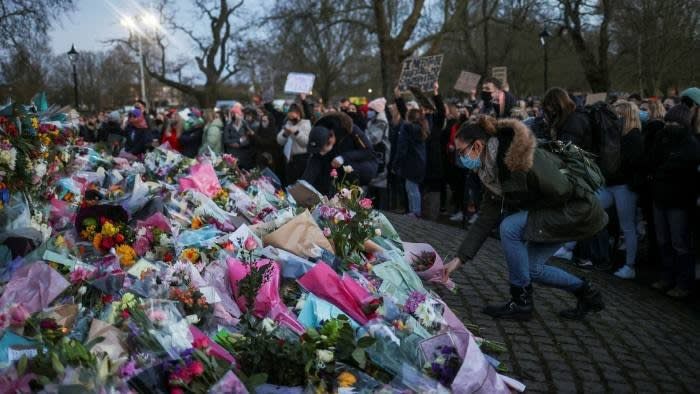 People gather on Clapham Common, London, at a memorial to Sarah Everard, whose killing has prompted an outcry from women demanding better protection © Hannah McKay/Reuters