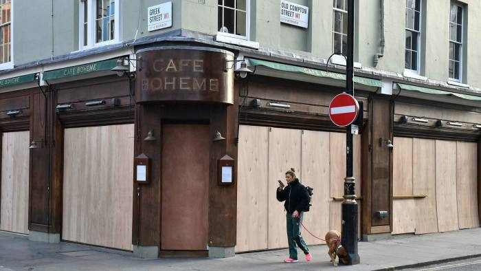 A café in Soho, London, is boarded up the day after pubs and restaurants across the UK were ordered to close last month to stop the spread of coronavirus