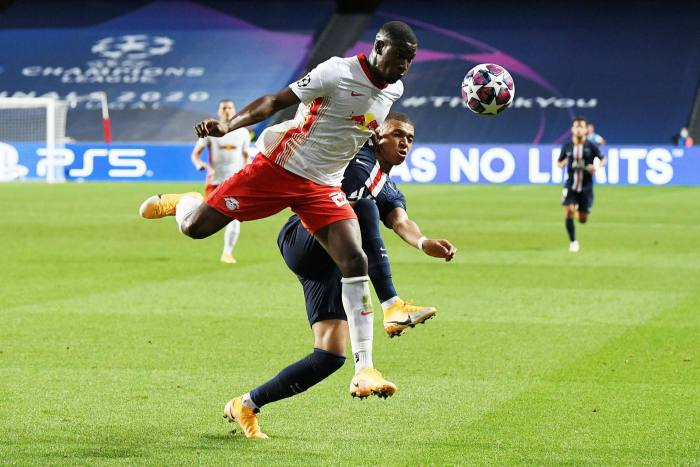 RB Leipzig'sNordi Mukiele faces a challenge from Kylian Mbappé of Paris Saint-Germain during this year's Champions League semi-final in Lisbon