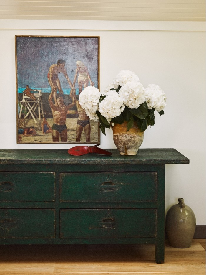 Brown and Konig's sitting room, with a green chest by Original House, untitled painting from Lacy Gallery and hydrangeas by Flowerbx