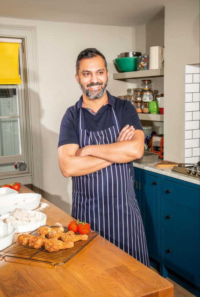 Ajesh Patalay with his deep-fried chicken drumsticks dredged in Grace's Perfect Blend seasoned flour from County Limerick, based on Colonel Sanders' original recipe