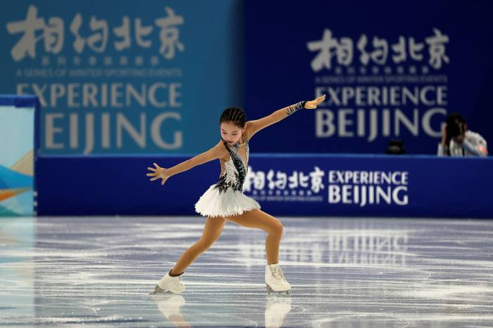 Chinese figure skater Xu Jingyu performs during a test event for the 2022 Beijing Winter Olympics at the Capital Indoor Stadium in Beijing