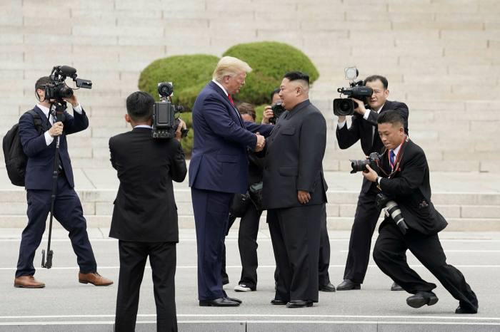 Then president Donald Trump meets North Korean leader Kim Jong Un at the demilitarised zone separating the two Koreas in June 2019