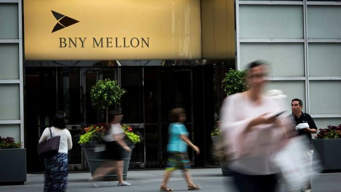 Pedestrians outside the BNY Mellon building in New York