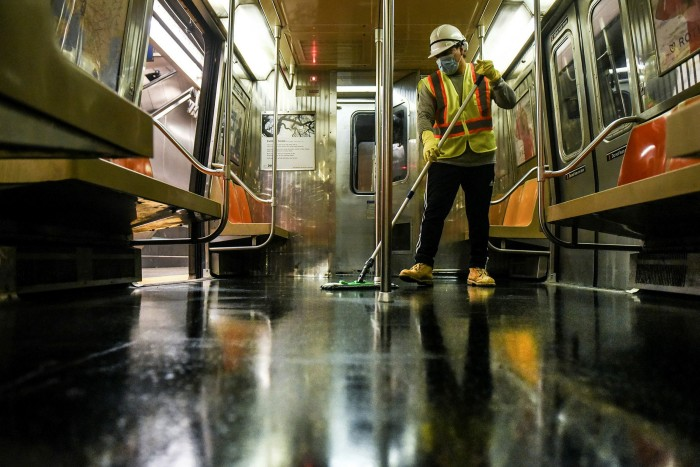 A cleaning crew disinfects a New York City subway train in May