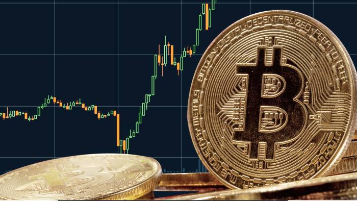 Montage of physical bitcoin with data chart