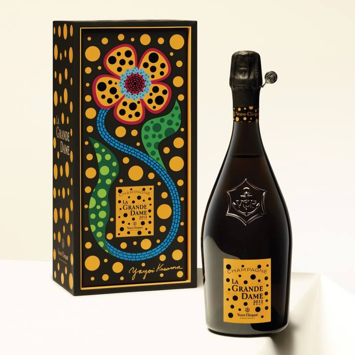 The artist's trademark dots and flowers also swirl around the vintage's gift box and label