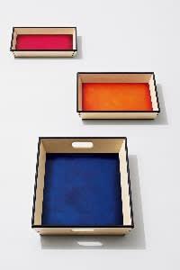 Maple,ebony and Venezia leather trays byBottega Ghianda, from£1,290