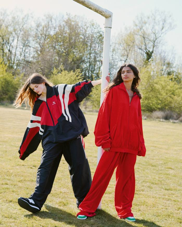 From left: Primrose wears Balenciaga nylon jacket, £1,250, and trousers, £850. New Balance 237 trainers, £75. Scarlett wears Balenciaga velvet jacket, £1,190, and trousers, £725. Nike vintage shoes, Scarlett's own