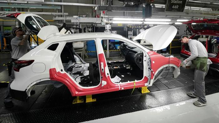 Workers on the production line at Nissan's factory in Sunderland, north-east England, last year