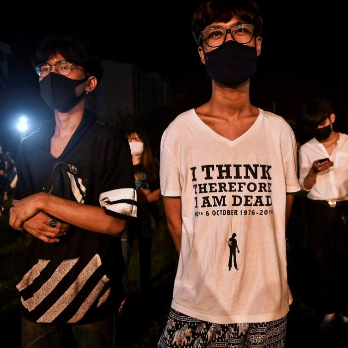 A protester wears a T-shirt referencing the Thammasat University killings at an anti-government rally at Mahidol University in Nakhon Pathom on August 18