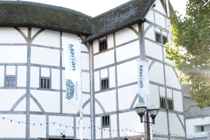 Merian's sponsorship flags catch the breeze at the Globe theatre