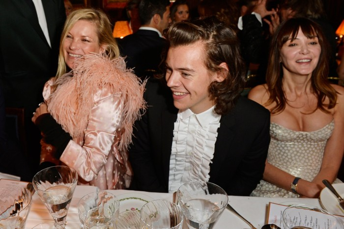 Harry Styles wearing a ruffled shirt at Annabel's in 2014, with Kate Moss