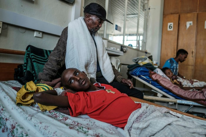 Kahsay Tesfay waits for his son Mikael, 16, to undergo surgery in Mekelle to amputate his foot after he was caught in a bomb blast