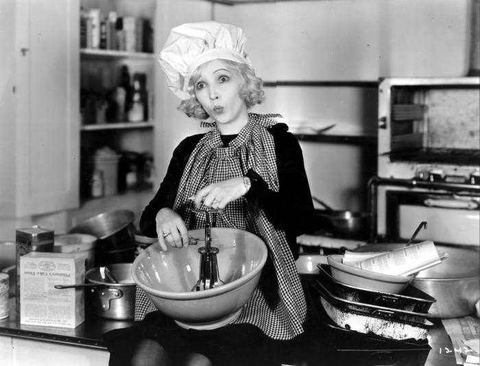 "Actress Bessie Love whistles while she ""cooks"", c1929"