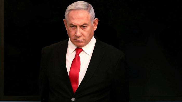 Benjamin Netanyahu at his office in Jerusalem in March. He will serve as Israel's prime minister for the next 18 months.