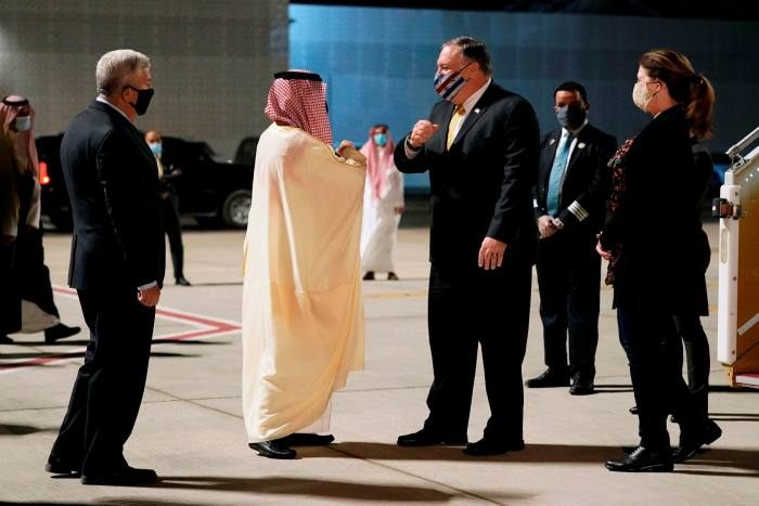Saudi foreign minister Prince Faisal bin Farhan (centre left) greets US Secretary of State Mike Pompeo (centre right) at Neom Bay airport in Neom, Saudi Arabia on Sunday