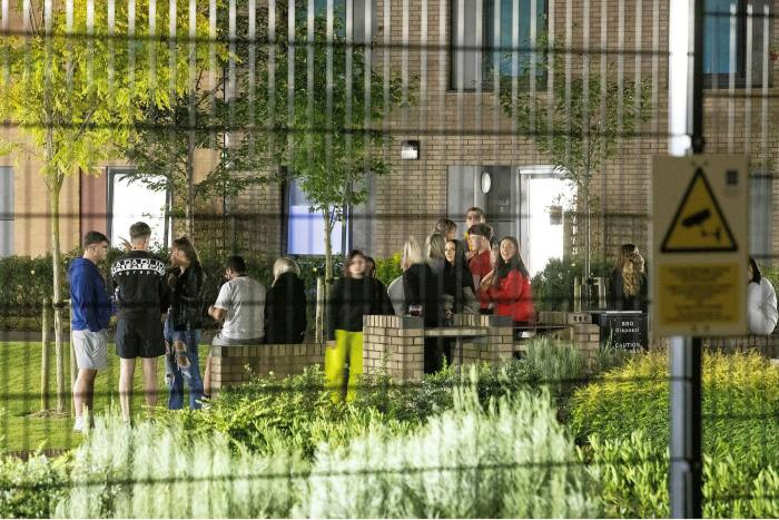 Students at Manchester Metropolitan University. Within weeks of term beginning,1,700 students in two accommodation blocks at the university were told to self-isolate