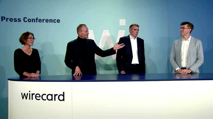 Wirecard chief product officer Susanne Steidl, former CEO Markus Braun, chief financial officer Alexander von Knoop and current CEO James Freis during a statement at the company's Aschheim headquarters on July 8