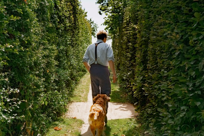 Don in his garden with his dog, Nellie