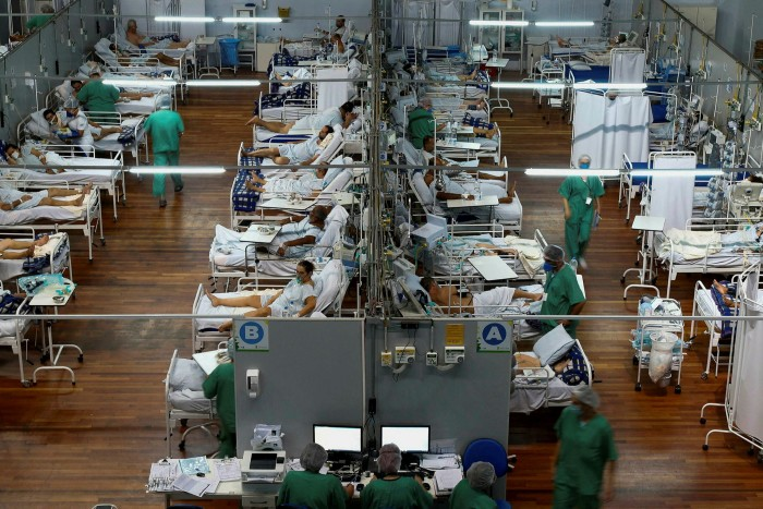 Covid-19 patients at a field hospital set up at a sports gym, in Santo André, Sao Pãulo. Record death tolls are turning Brazil into the global epicentre of the pandemic