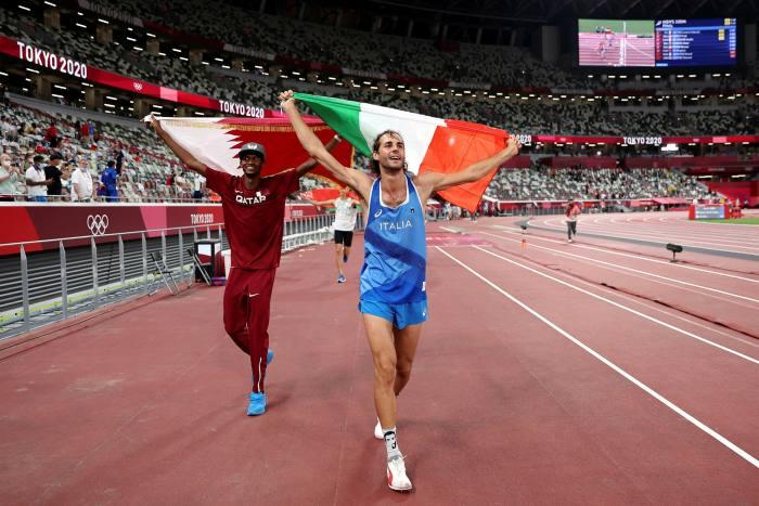 High jumpers Mutaz Essa Barshim of Qatar and Gianmarco Tamberi of Italy share victory