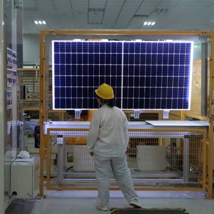 Quality checks of a solar module product at a factory of a monocrystalline silicon solar equipment manufacturer LONGi Green Technology Co, in Xian, Shaanxi province