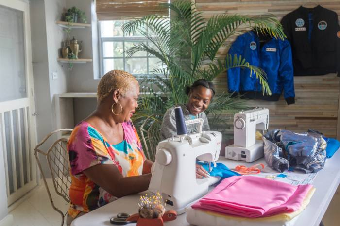 Strachan's mother Ella – seen here with his niece – makes bomber jackets for BASEC