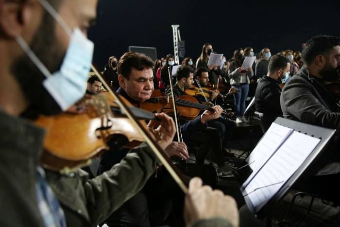Musicians and singers of a joint Kurdish and Christian orchestra and choir rehearse at Erbil Stadium, in the Kurdistan region of Iraq ahead of Pope Francis's visit, on March 1 2021
