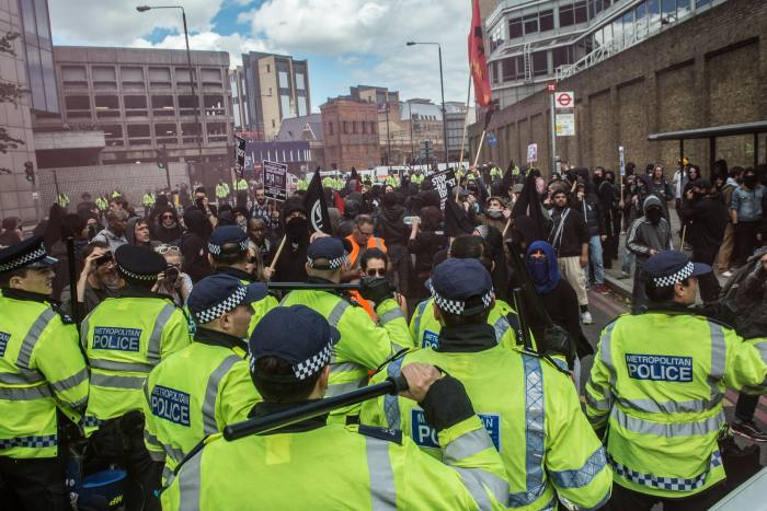 Police detaining protesters in London, 2013