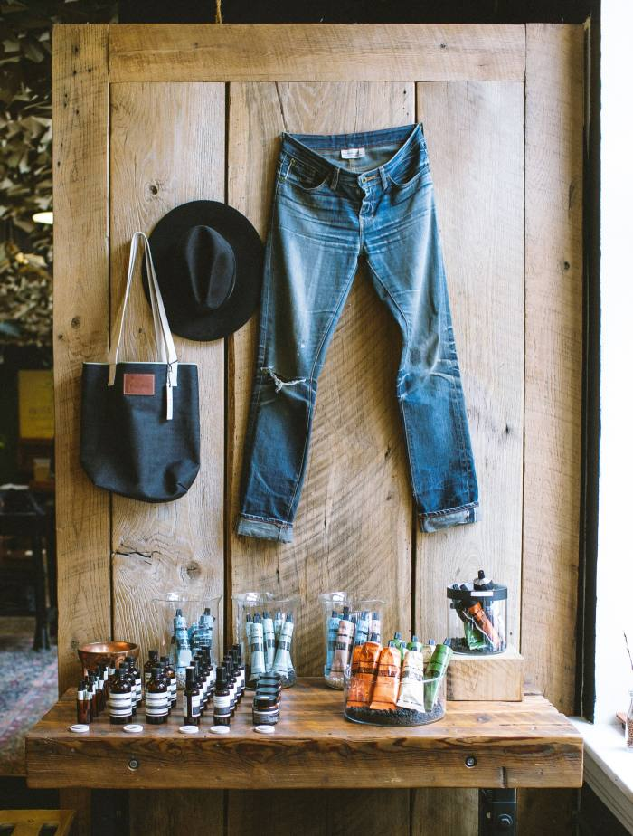 Raleigh Denim Workshop Hall of Fame jeans (not for sale), with the brand's Original Raw Selvedge tote bag, $45, and other accessories