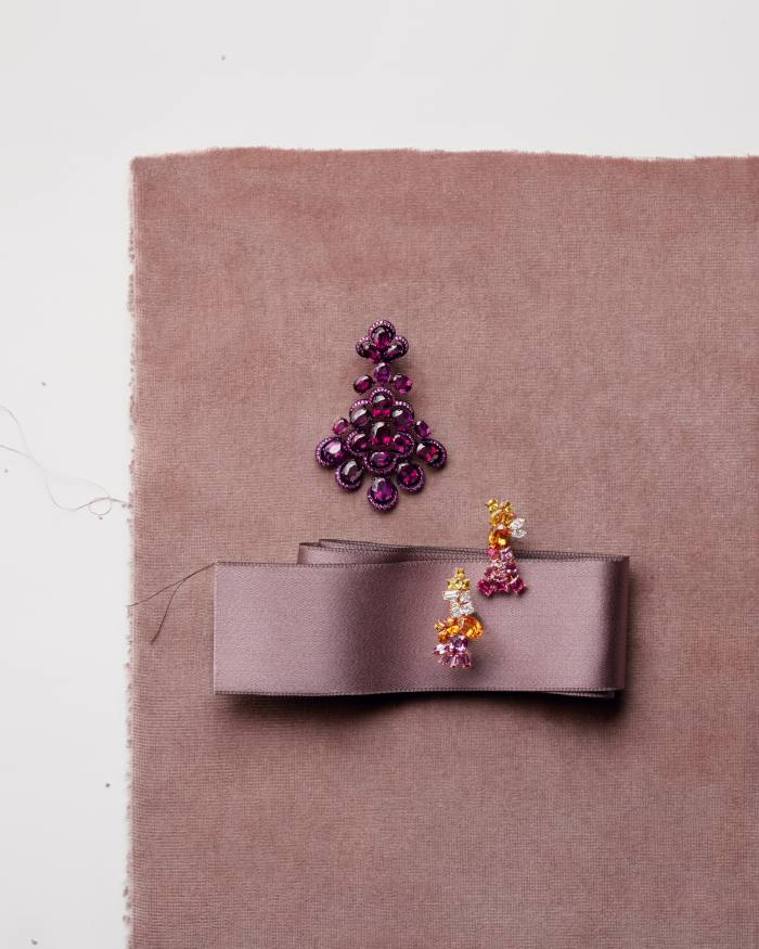 From top: Chopard titanium, rhodolite and pink-sapphire Red Carpet earring (sold as pair), POA. Dior Joailleriepink-gold, diamond, spessartite garnet and pink- and yellow-sapphire Gem Dior earrings, POA. Julien Fauresatin Envers Faille 42516 ribbon