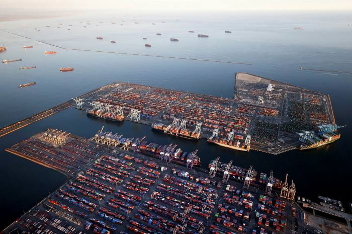 Container ships anchored by the ports of Long Beach and Los Angeles as they wait to offload