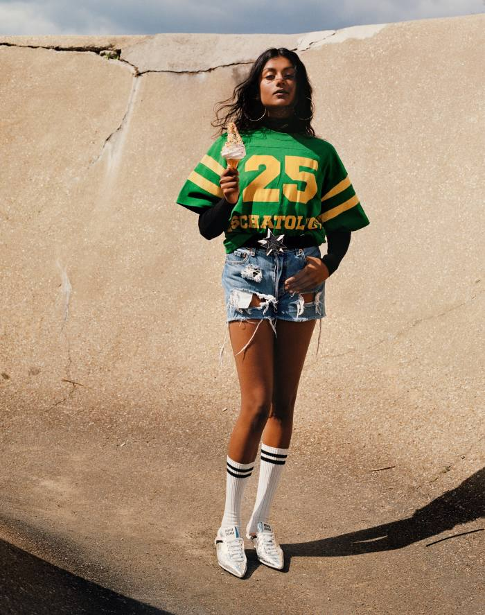 Gucci cotton jersey crewneck, £400, and fine-wool turtleneck, £660. Miu Miu technical fabric sneakers, £750. Vintage gold hoop earrings, POA, from Contemporary Wardrobe. Vintage 1980s elasticated nylon and resin belt, POA, from Carlo Manzi. Vintage denim shorts and cotton sport socks, both POA, from Costume Studio